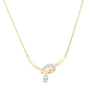 Collier 750/18 K or jaune avec topaze bleue ovale et diamants 0.02ct.