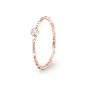 Bague 750/18 K or rose avec diamant 0.03  ct H/si by CHRISTIAN