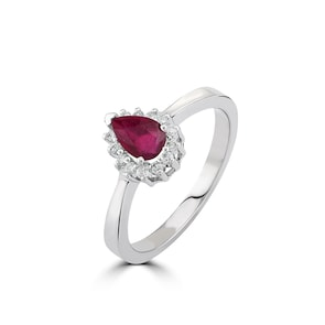 Bague 750/18 K or gris avec diamants 0.11 ct H/si et rubis 0.56 ct